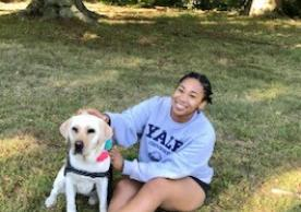 Nature Immersion Meditation participant Lauren Wiggins with Heidi the service dog