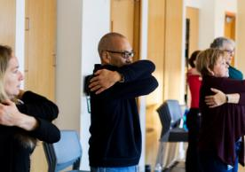 Rise and Shine participants practice self-soothing with the big hug stretch. Image credit: Heather Smith